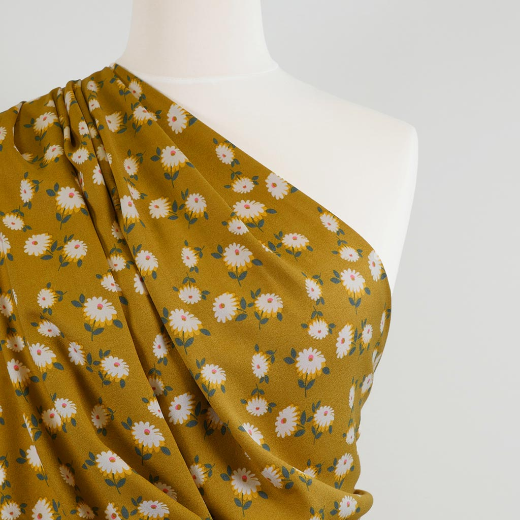 Loire Ochre Double Daisies Viscose Crepe Fabric Mannequin Closeup Image from Patternsandplains.com