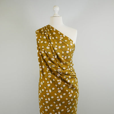 Loire Ochre Double Daisies Viscose Crepe Fabric Mannequin Wide Image from Patternsandplains.com