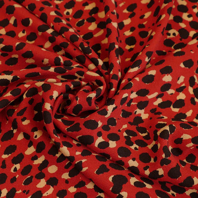 Loire - Red Double Spots Viscose Crepe Fabric Detail Swirl Image from Patternsandplains.com