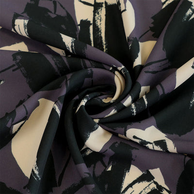 Madrid 278129 Plum Tulip Impression Woven Crepe Fabric from John Kaldor Detail Swirl Image from Patternsandplains.com