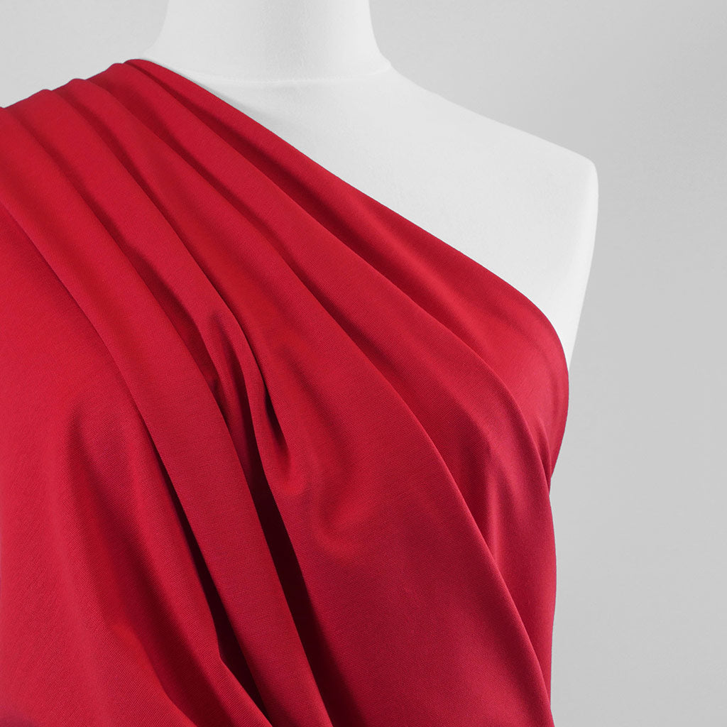 Milan - Bright Red Viscose Rich Ponte de Roma Fabric Mannequin Close Up Image from Patternsandplains.com