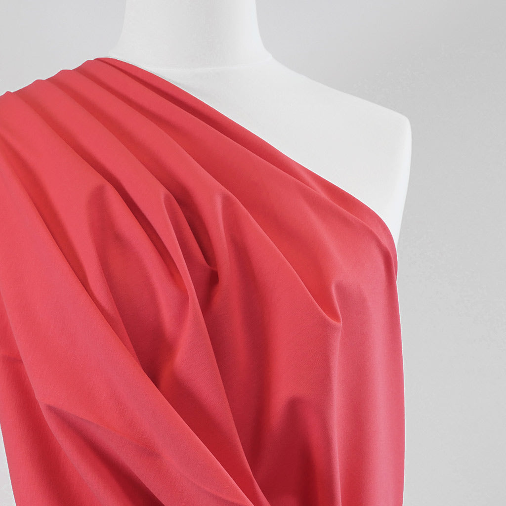 Milan - Coral Pink Viscose Rich Ponte de Roma Fabric Mannequin Close Up Image from Patternsandplains.com