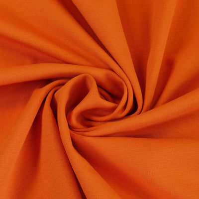 Milan - Pumpkin Orange Viscose Rich Ponte de Roma Fabric Detail Swirl Image from Patternsandplains.com