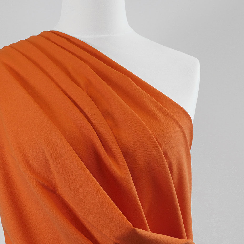 Milan - Pumpkin Orange Viscose Rich Ponte de Roma Fabric Mannequin Close Up Image from Patternsandplains.com