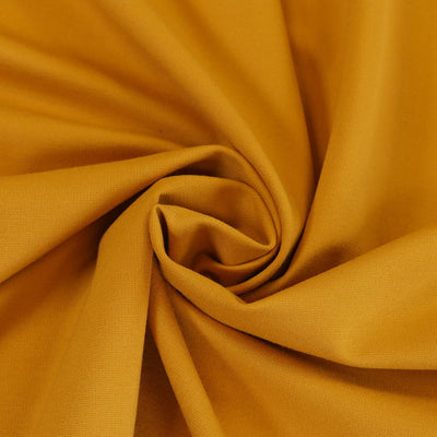Milan - Saffron Yellow Viscose Rich Ponte de Roma Fabric Detail Swirl Image from Patternsandplains.com