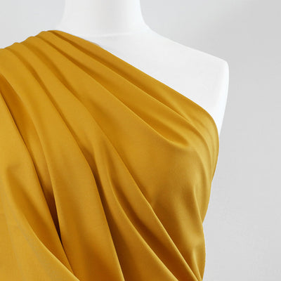 Milan - Saffron Yellow Viscose Rich Ponte de Roma Fabric Mannequin Close Up Image from Patternsandplains.com