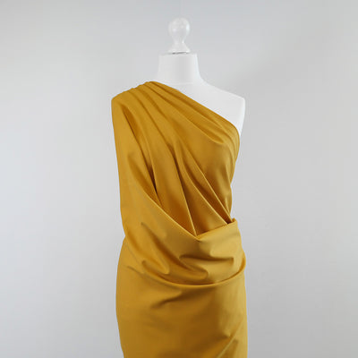 Milan - Saffron Yellow Viscose Rich Ponte de Roma Fabric Mannequin Wide Image from Patternsandplains.com