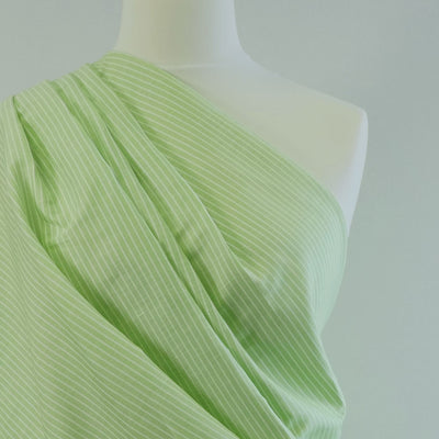 Moira Stripe Lime Green and White Linen-Cotton Woven Fabric Mannequin Closeup Image from Patternsandplains.com
