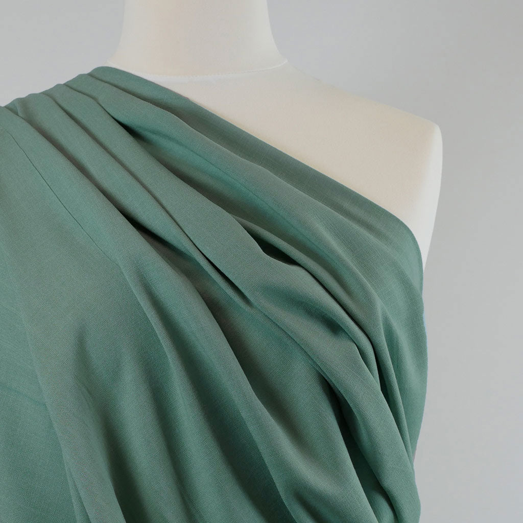Nice - Faded Teal, Stretch Viscose Lightweight Woven Fabric Mannequin Closeup Image from Patternsandplains.com