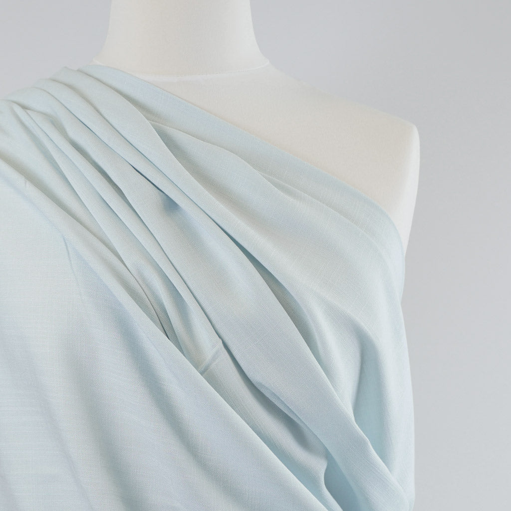 Nice Pale Mint Green, Stretch Viscose Lightweight Woven Fabric Mannequin Closeup Image from Patternandplains.com