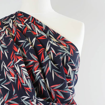 Peaseblossom 279162 Red on Navy Dry Crepe Woven Fabric from John Kaldor Mannequin Closeup Image from Patternsandplains.com