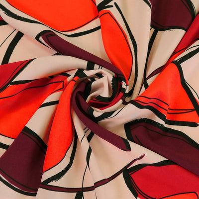 Peaseblossom 5033 - Red and Plum Bold Leaves Dry Woven Crepe Fabric from John Kaldor Detail Swirl Image from Patternsandplains.com