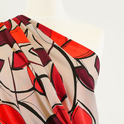 Peaseblossom 5033 - Red and Plum Bold Leaves Dry Woven Crepe Fabric from John Kaldor Mannequin Close Up Image from Patternsandplains.com