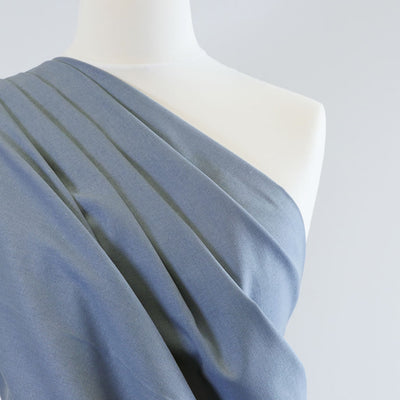 Phoenix - Washed Denim Blue Recycled Viscose and Linen Woven Fabric Mannequin Closeup Image from Patternsandplains.com