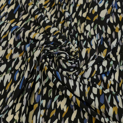 Portia 5220 Yellow Green Black Abstract Stretch Jersey Fabric John Kaldor Detail Swirl Image from Patternsandplains.com