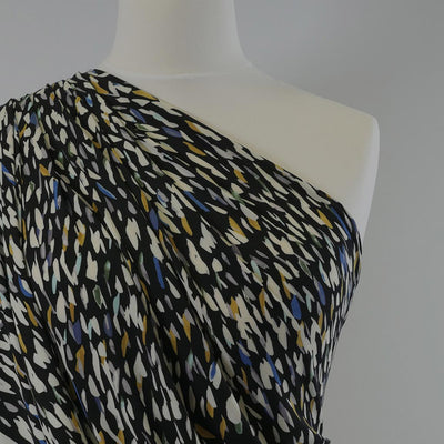 Portia 5220 Yellow Green Black Abstract Stretch Jersey Fabric John Kaldor Mannequin Closeup Image from Patternsandplains.com