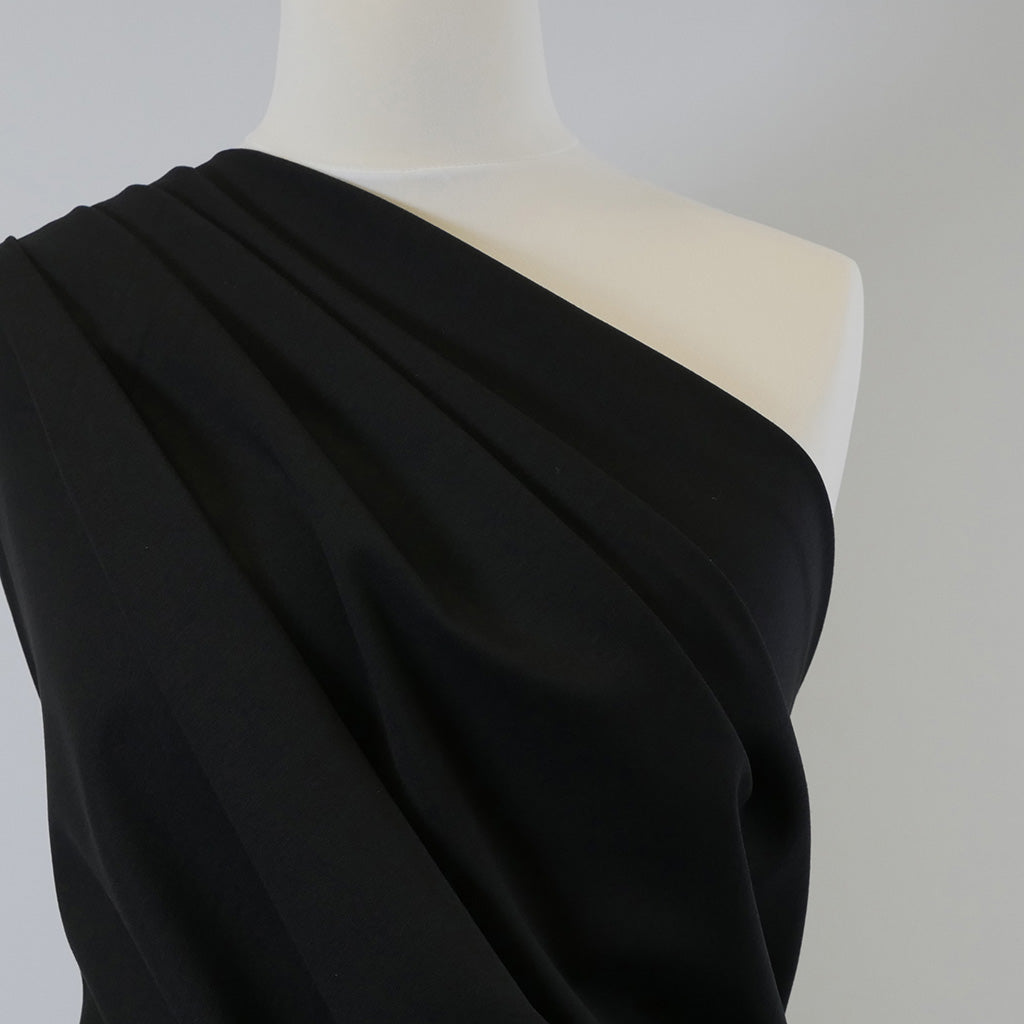 Rome - Black, Viscose Rich Heavy Ponte de Roma Stretch Fabric Mannequin Closeup Image from Patternsandplains.com