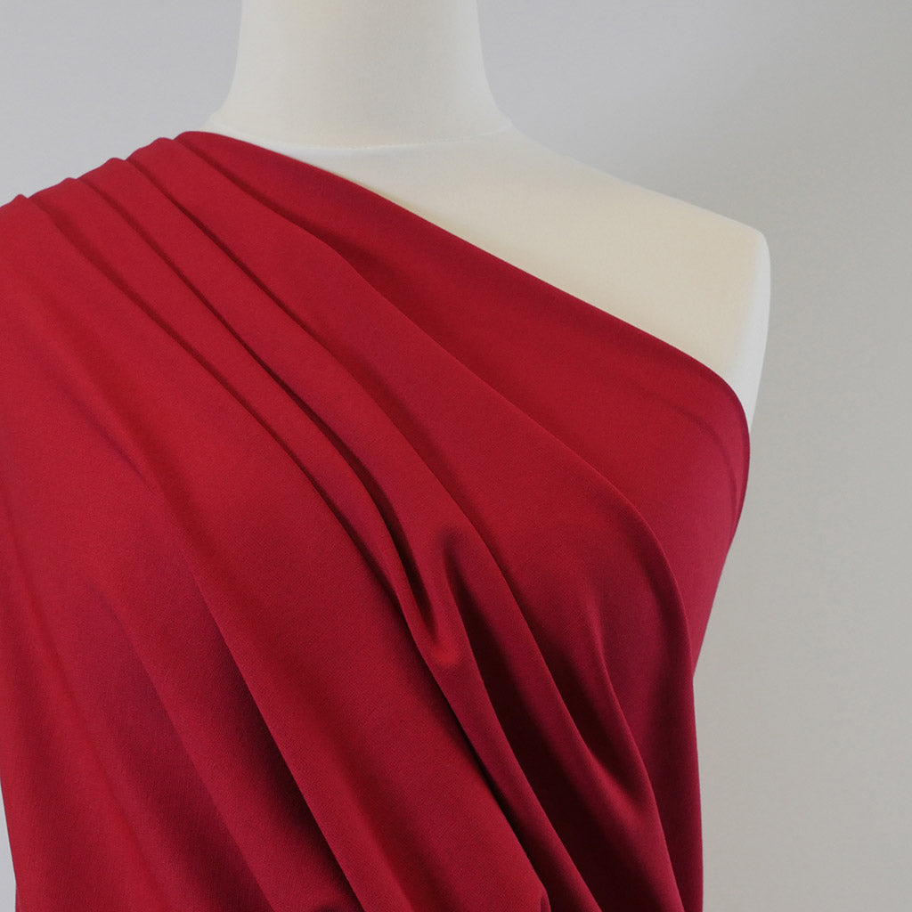 Rome Real Red, Viscose Rich Heavy Ponte de Roma Stretch Fabric Mannequin Closeup Image from Patternsandplains.com