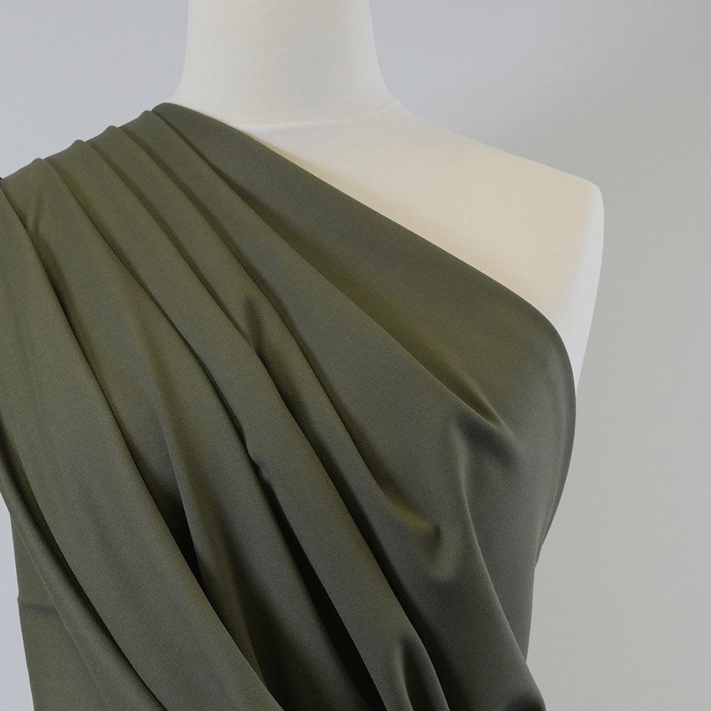 Rome Sage Green Viscose Rich Heavy Ponte de Roma Stretch Fabric Mannequin Closeup Image from Patternsandplains.com