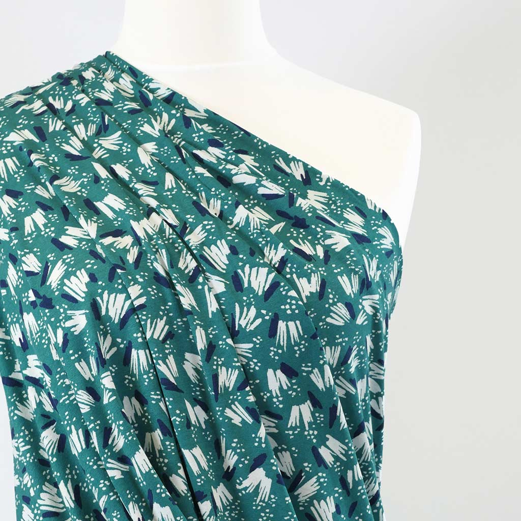 Seville Too - Sea Green, Jots and Dots Single Jersey Stretch Viscose Elastane Print Fabric Mannequin Close Up Image from Patternsandplains.com