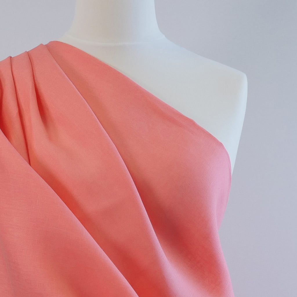 Skea Bright Coral 100% Linen Woven Fabric Mannequin Closeup Image From Patternsandplains.com