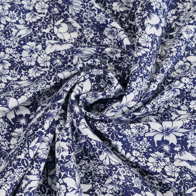 Somerby - Navy and White Busy Flowers Single Jersey Stretch Viscose Elastane Fabric Detail Swirl Image from Patternsandplains.com