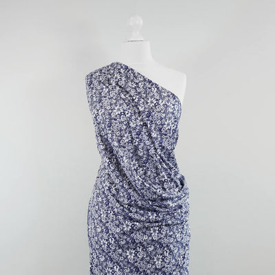 Somerby - Navy and White Busy Flowers Single Jersey Stretch Viscose Elastane Fabric Mannequin Wide Image from Patternsandplains.com