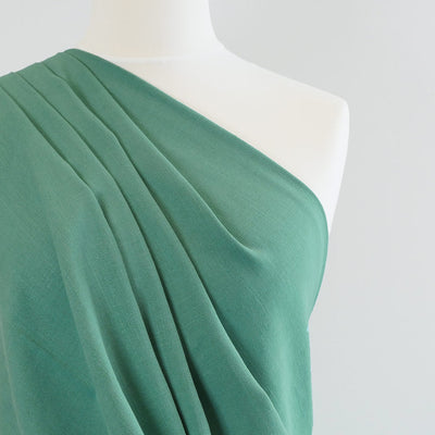 Spa - Lagoon Green Viscose and Linen Woven Fabric Mannequin Closeup Image from Patternsandplains.com