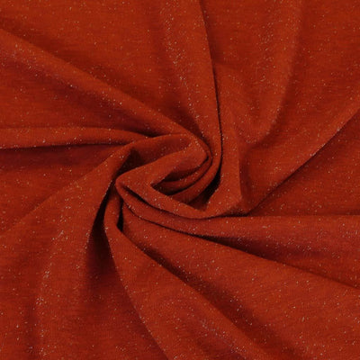Sparks - Brick Red Scuba Crepe Stretch Fabric Detail Swirl Image from Patternsandplains.com