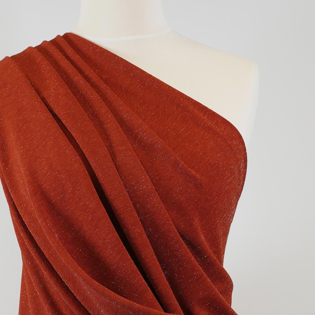 Sparks - Brick Red Scuba Crepe Stretch Fabric Mannequin Close Up Image from Patternsandplains.com