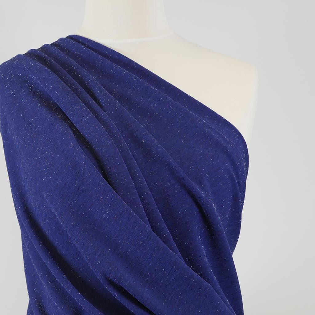 Sparks - Ultramarine Blue Scuba Crepe Stretch Fabric Mannequin Close Up Image from Patternsandplains.com