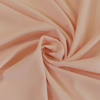 Tivoli Apricot Light Scuba Stretch Crepe Fabric Detail Swirl Image from Patternsandplains.com