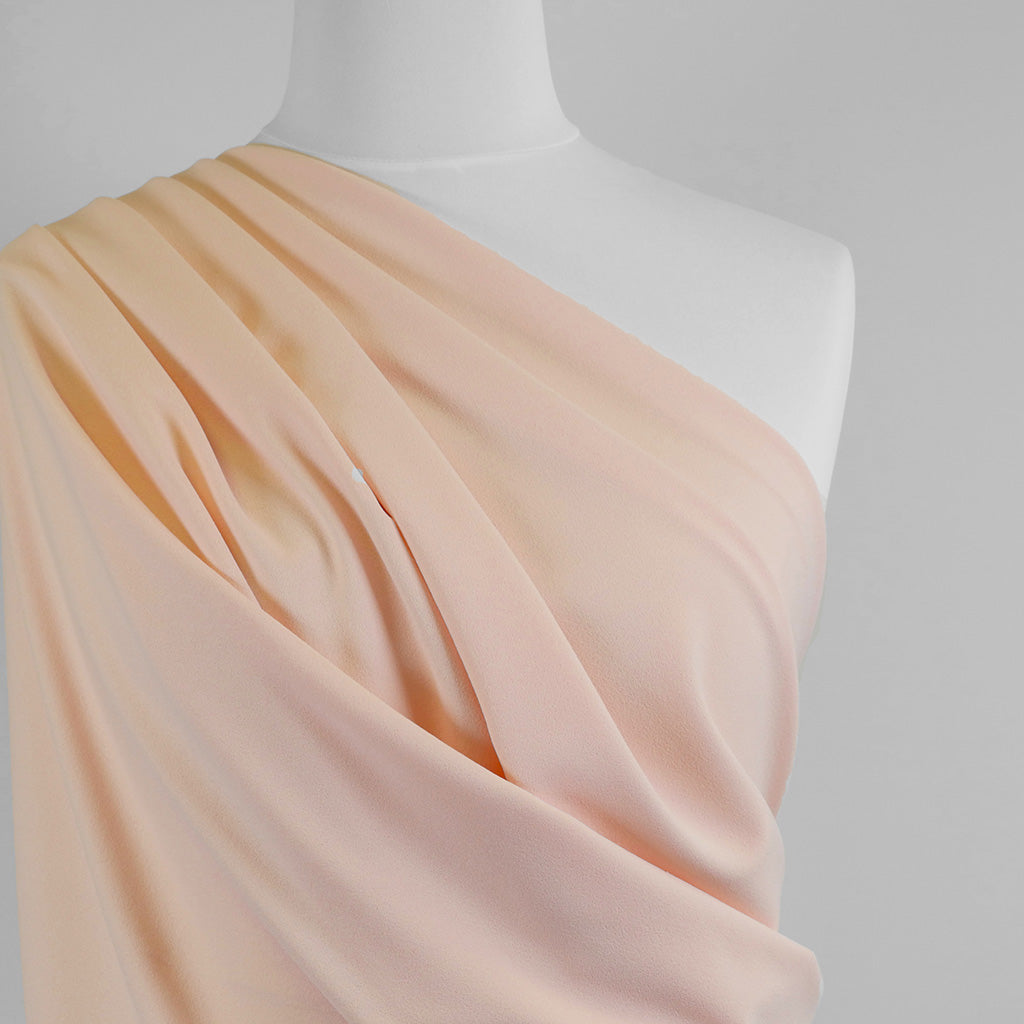 Tivoli Apricot Light Scuba Stretch Crepe Fabric Mannequin Closeup Image from Patternsandplains.com