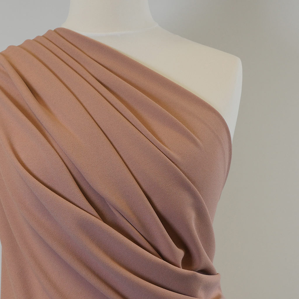 Tivoli - Dusty Pink, Light Scuba Stretch Crepe Fabric Mannequin Closeup Image from Patternsandplains.com
