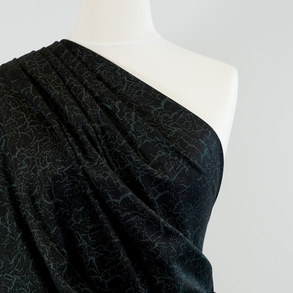Tosca Black with Moss Green Viscose Rich Ponte de Roma Fabric Mannequin Closeup Image from Patternsandplains.com