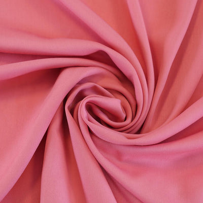 Trieste- Carnation Pink Modal, Bamboo and Tencel Woven Fabric Detail Swirl Image from Patternsandplains.com