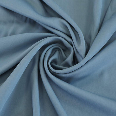 Trieste- Light Teal Modal, Bamboo and Tencel Woven Fabric Mannequin Closeup Image from Patternsandplains.com Detail Swirl Image from Patternsandplains.com