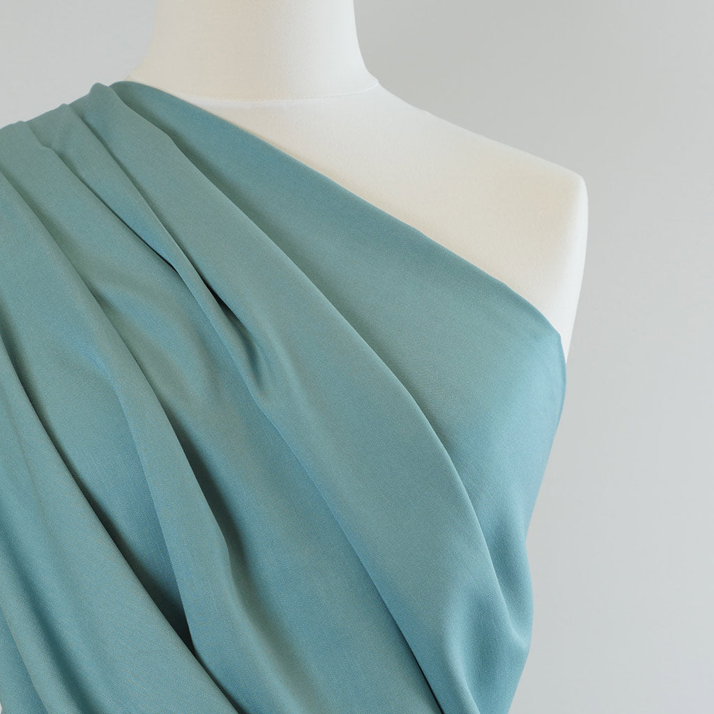 Trieste- Light Teal Modal, Bamboo and Tencel Woven Fabric Mannequin Closeup Image from Patternsandplains.com