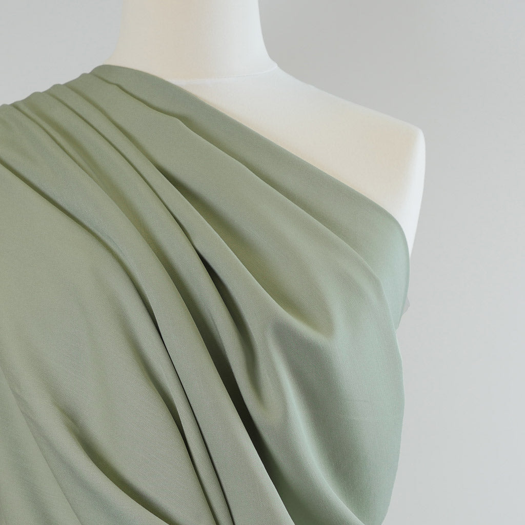Trieste- Sage Green Modal, Bamboo and Tencel Woven Fabric Mannequin Closeup Image from Patternsandplains.com