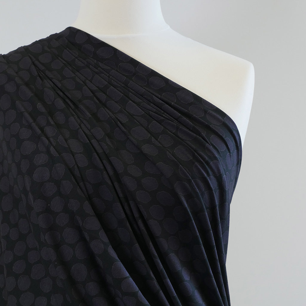 Valencia- Aubergene on Black Pebbles Single Jersey, Stretch Viscose Elastane Fabric Mannequin Closeup Image from Patternsandplains.com