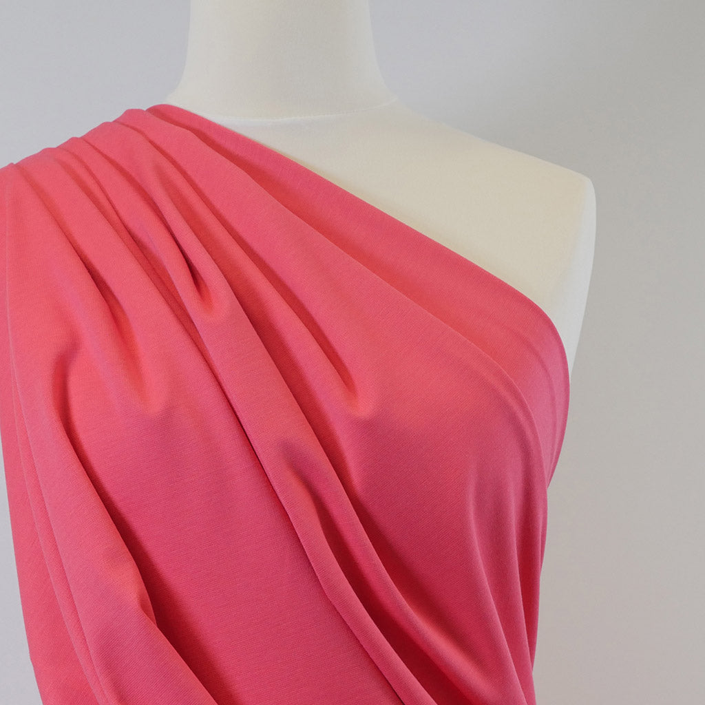 Venice Coral Pink Ponte de Roma Stretch Fabric Mannequin Closeup Image from Patternsandplains.com