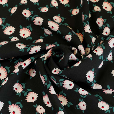 Loire Black Double Daisies Viscose Crepe Fabric Detail Swirl Image from Patternsandplains.com