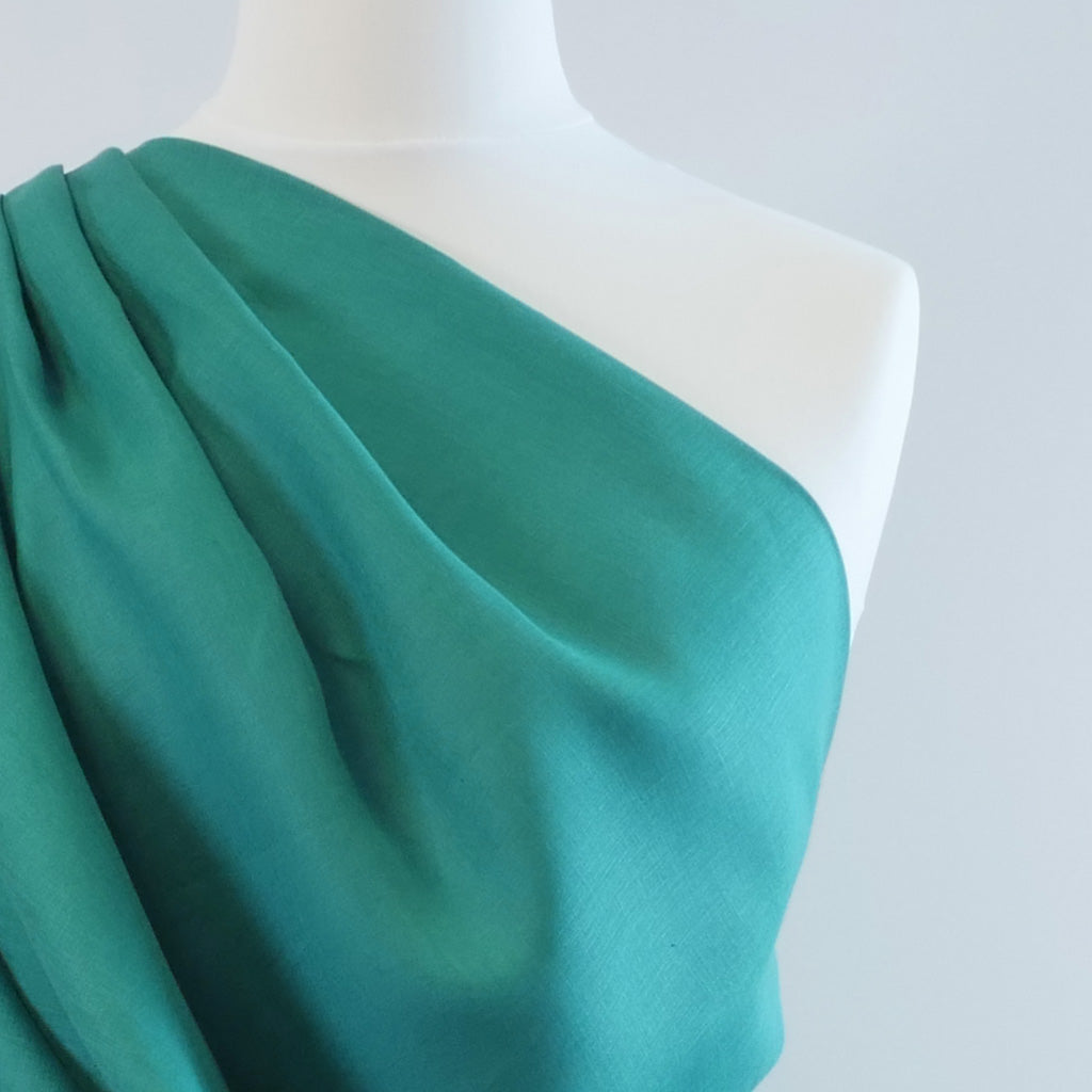 Skea Dark Turquoise Pue Linen Woven Fabric Mannequin Closeup Image from Patternsandplains.com