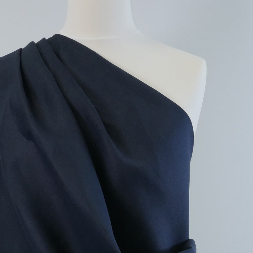 Skea Navy Pure Linen Woven Fabric Night Time Mannequin Closeup Image from patternsandplains.com