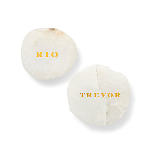 Luxe place cards are geometric stone tiles with customized script.