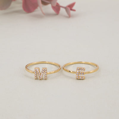 "Pavé Crystal rings spelling the word ""me"""