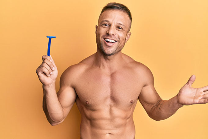 a smiling man holding a razor