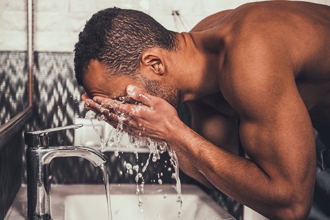 washing face over sink