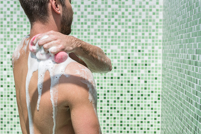 youthful bearded guy washing