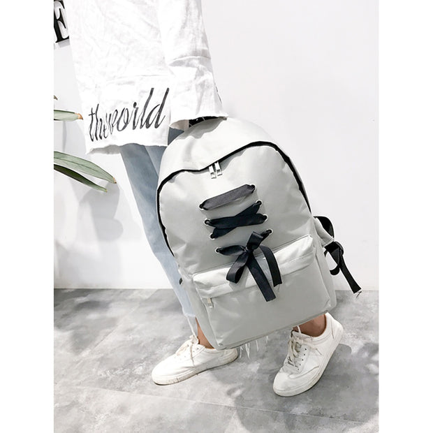 Criss Cross Zipper Front Backpack